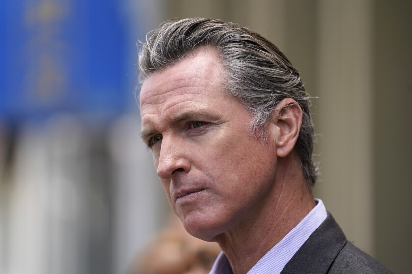 FILE - In this June 3, 2021 file photo, California Gov. Gavin Newsom listens to questions during a news conference outside a restaurant in San Francisco. Six weeks after California officials announced that Newsom would face an almost certain recall election, the contest remains framed by uncertainty even the date when it might take place is unclear. (AP Photo/Eric Risberg,File)