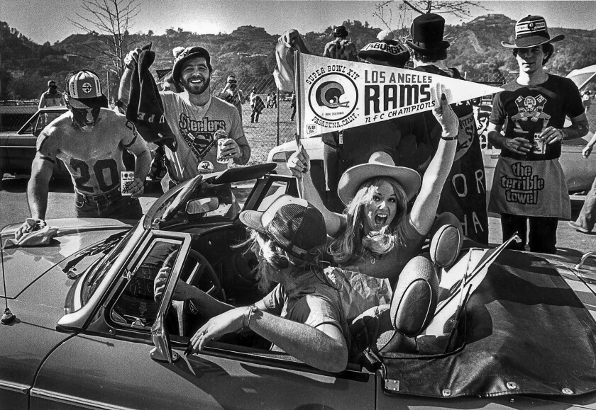 Jan. 20, 1980: Fans of the Los Angeles Rams and Pittsburgh Steelers trade cheers and beers outside the Rose Bowl before Super Bowl XIV.