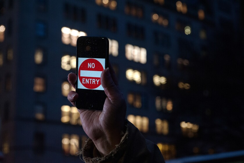 A demonstrator outside of the the Apple store in New York City last month expresses support for the company's refusal to give authorities a backdoor into devices.