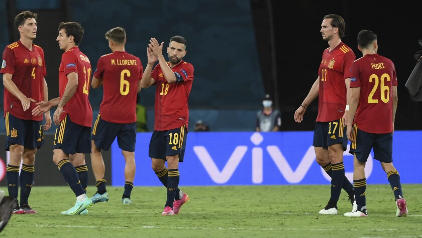 Spanish players react after the Euro 2020 soccer championship group E match between Spain and Poland at the La Cartuja stadium in Seville, Spain, Saturday, June 19, 2021. (Lluis Gene/Pool via AP)
