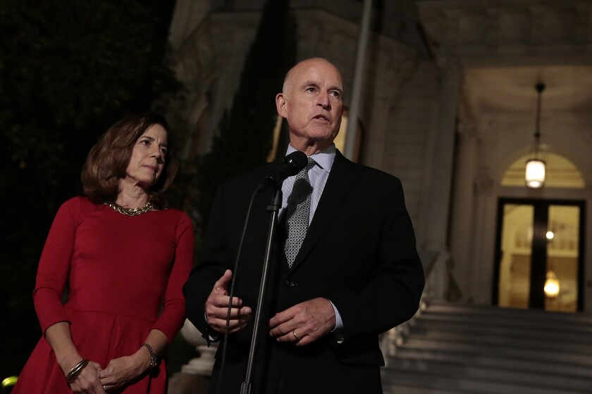 Gov. Jerry Brown and wife, Anne Gust Brown, on the steps of the governor's mansion in Sacramento after he won reelection Nov. 4.