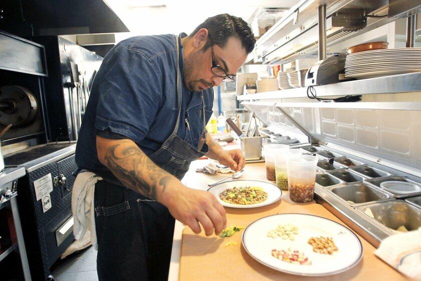 Chef Vince Schofield makes bean dishes at Catania Coastal Italian in La Jolla.