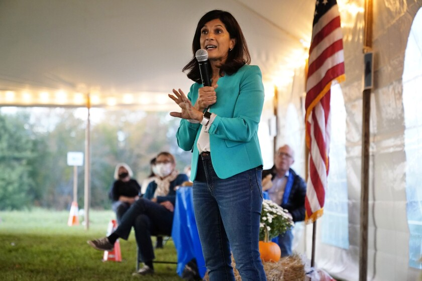 """Sara Gideon, a Democratic candidate for U.S. Senate, speaks at a """"Supper with Sara"""" campaign event, Thursday, Oct. 1, 2020, in Dayton, Maine. (AP Photo/Robert F. Bukaty)"""