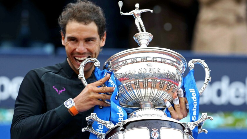 Rafael Nadal celebrates with the winner's trophy Sunday at the Barcelona Open.