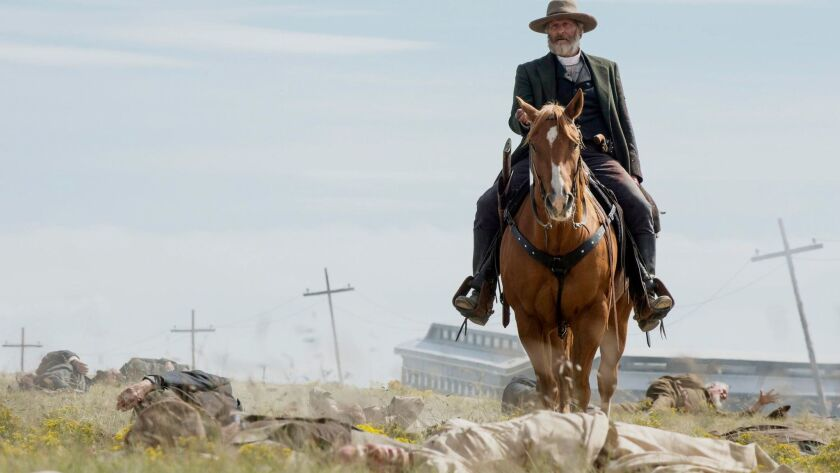 "Frank Griffin (Jeff Daniels) riding through the dead in ""Godless."""