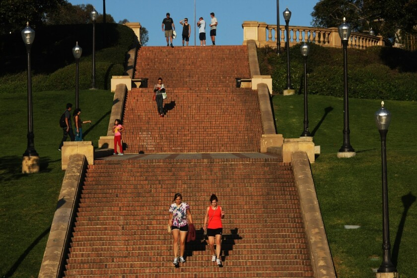 Nearly every faculty member of color had achieved tenure and professional success, the report said, but they were still upset by incidents of perceived bias. Above, students walk the campus' Janss Steps in August.