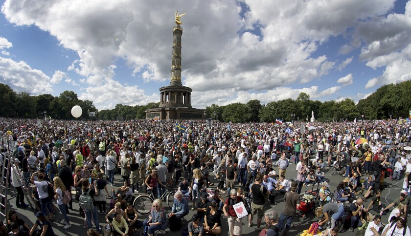 Thousands attended a protest in Berlin against new coronavirus restrictions in Germany on Saturday.