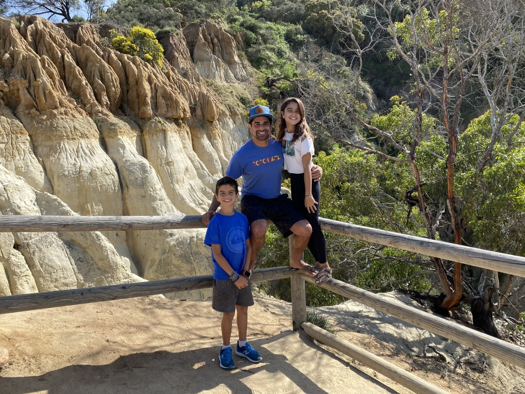 Samir Bhavnani with his two children at Annie's Canyon Trail in Encinitas.