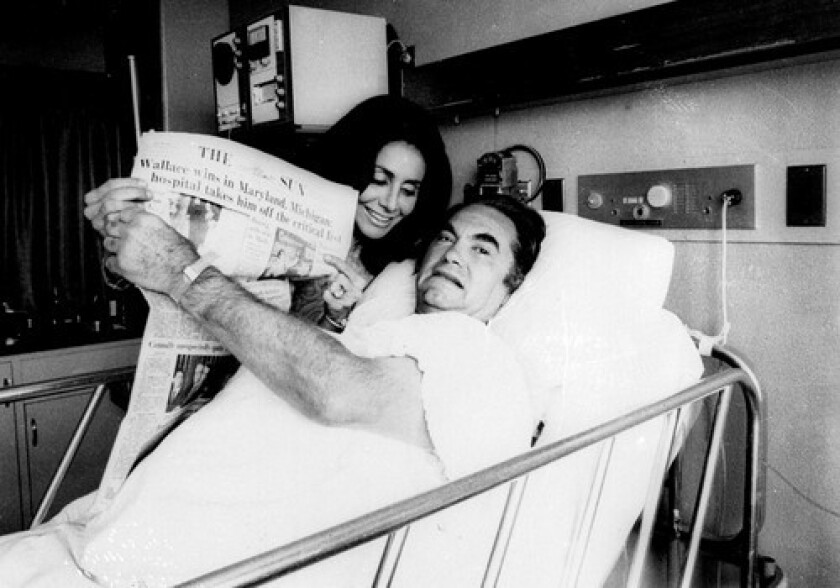 Then-Alabama first lady Cornelia Wallace joins George C. Wallace at his hospital bed after he was shot in 1972.