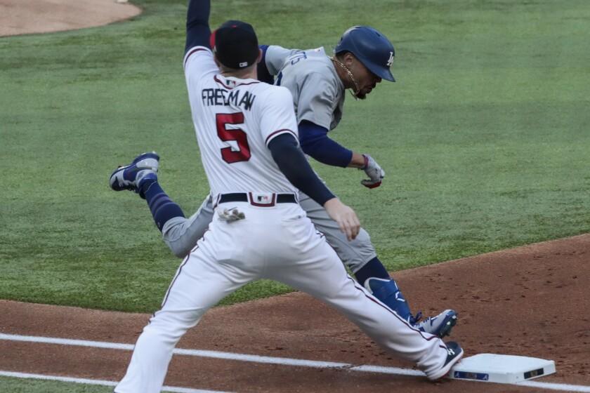 Dodgers' Mookie Betts beats the throw to Atlanta Braves first baseman Freddie Freeman.
