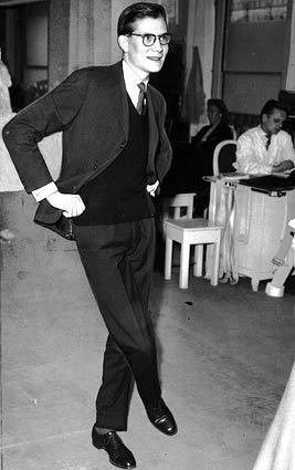 Yves Saint Laurent studies a creation in the Dior workroom in March 1958. When his mentor, Christian Dior, died suddenly the year before, Saint Laurent replaced him as chief designer.