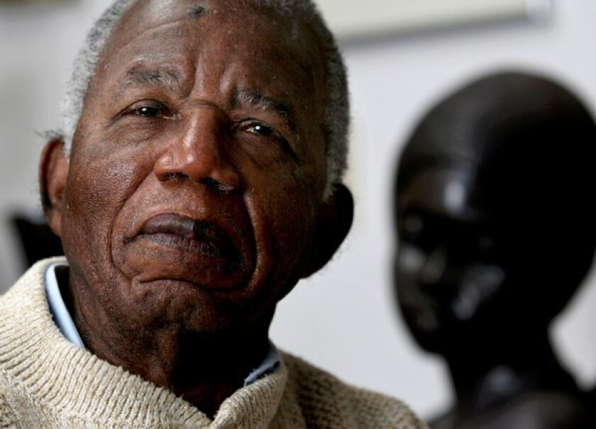 Chinua Achebe posed in 2008 at his home on the campus of Bard College in New York.