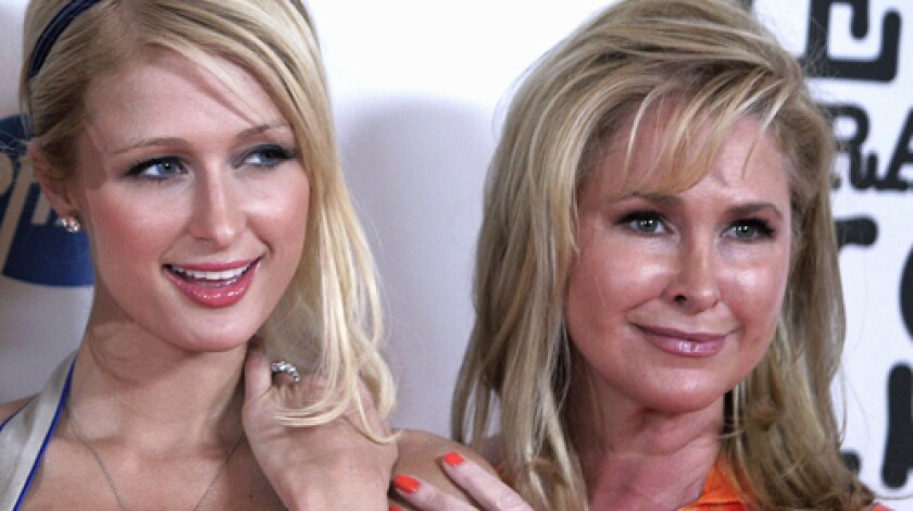 Kathy Hilton poses with her daughter, Paris, at an event in Los Angeles.