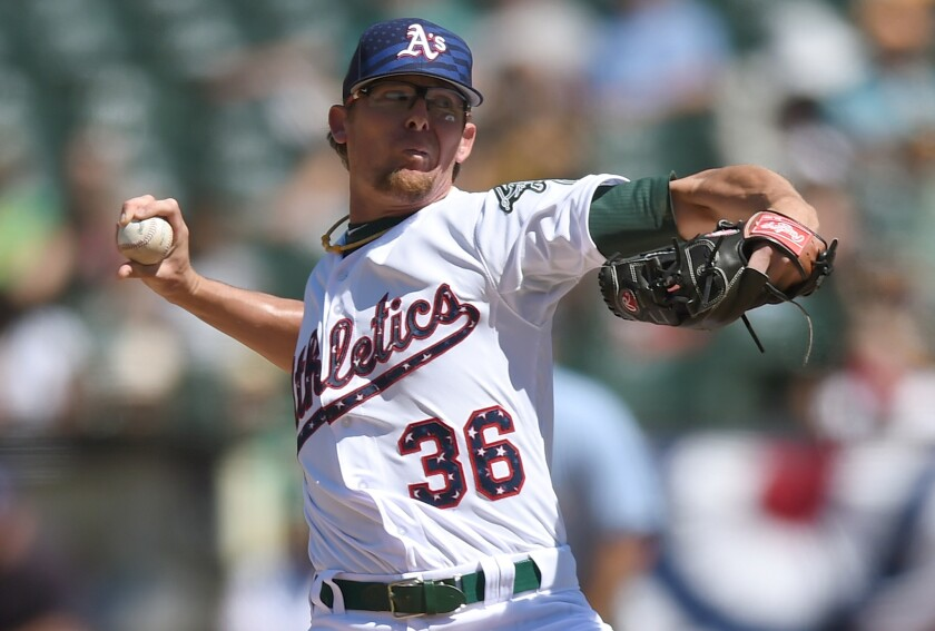 Athletics closer Tyler Clippard pitches a scoreless ninth inning to earn a save against the Mariners on July 4.