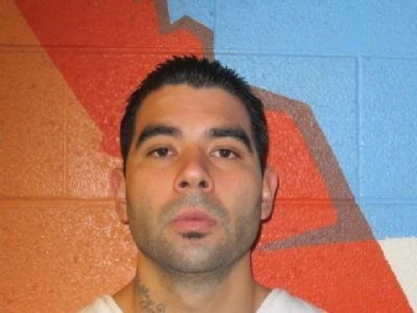 In this undated photo provided by the Utah Department of Corrections shows Jose Angel Garcia Juaregui. Officials say Utah County sheriff's Sgt. Cory Wride had stopped to check on a truck that appeared to be disabled on a two-lane highway Thursday, Jan. 30, 2014 afternoon. He was using his computer