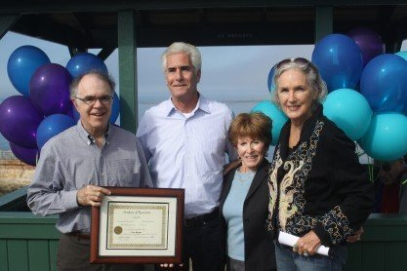 La Jolla Parks and Beaches chair Dan Allen hands a certificate of appreciation to Tom Morgan for his gift of $200,000 as project organizers Phyllis Minick and Melinda Merryweather look on. Ashley Mackin photos