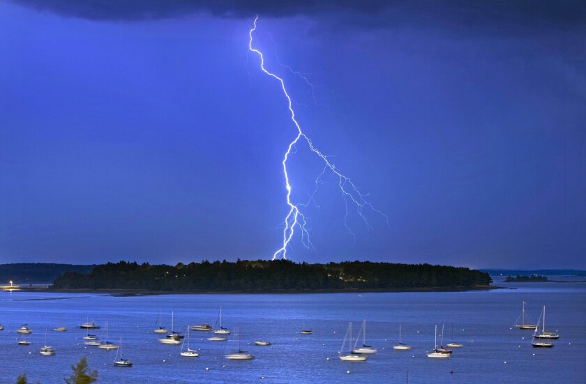 Lightning strikes north of Macworth Island in Portland, Maine, in September. A new study says lightning strikes in the U.S. will likely increase by nearly 50% by the end of the century because of climate change.