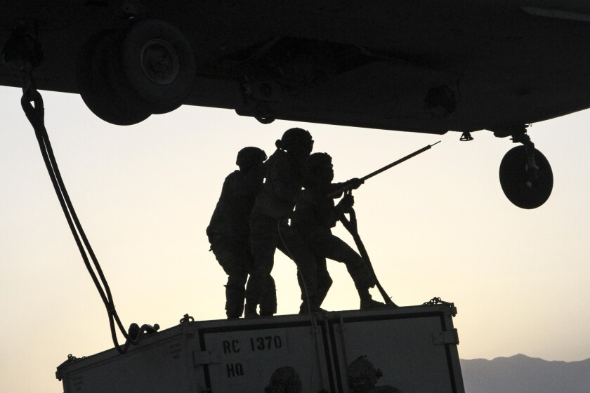 Soldiers conduct slingload operations at Bagram Airfield, Afghanistan, May 22, 2017. The soldiers are assigned to Task Force Muleskinner