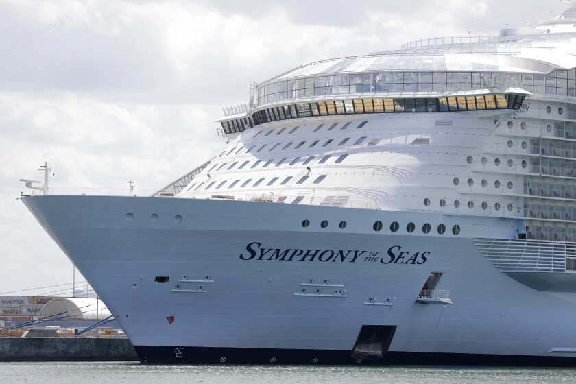 FILE - The Symphony of the Seas cruise ship is shown docked at PortMiami, in a Wednesday, May 20, 2020, file photo, in Miami. Cruise lines can soon begin trial voyages in U.S. waters. They'll have to carry some volunteer passengers, who will have to wear face masks and observe social distancing while on board. The Centers for Disease Control and Prevention gave ship operators final technical guidelines Wednesday, May 5, 2021 for the trial runs. (AP Photo/Wilfredo Lee, File)