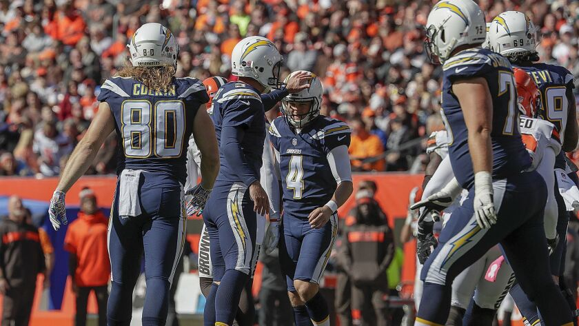Chargers kicker Michael Badgley is congratulated by teammates after making an extra point against the Browns.