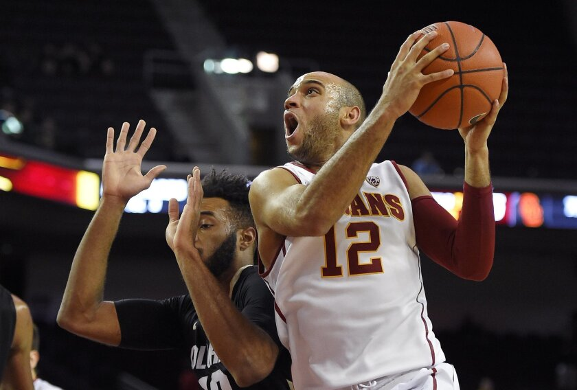Southern California guard Julian Jacobs, right, shoots as Colorado forward Tre'Shaun Fletcher defends during the second half of an NCAA college basketball game, Wednesday, Feb. 17, 2016, in Los Angeles.  USC won 79-72. (AP Photo/Mark J. Terrill)
