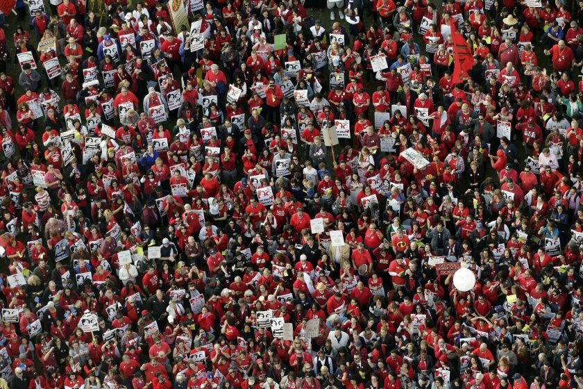 Thousands of teachers gather for a rally to demand higher wages and smaller class sizes amid stalled contract negotiations, Thursday, Feb. 26, 2015, in Los Angeles. United Teachers Los Angeles is asking for an 8.5 percent pay increase, a demand the Los Angeles Unified district says cannot be met without significant layoffs. (AP Photo/Jae C. Hong)