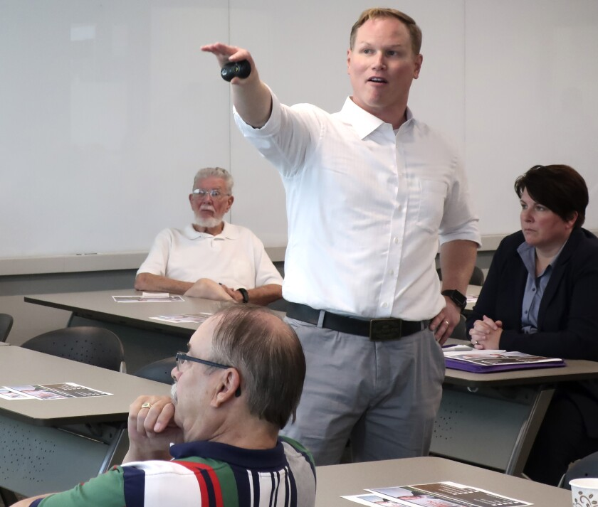 FILE - In this Aug. 26, 2019, file photo, U.S. Rep. Steve Watkins, R-Kan., makes a point during a town hall meeting, in Topeka, Kan. Authorities plan to investigate whether Watkins broke state laws by listing a UPS Inc. store as his address on a voter registration form and for obtaining a mail-in ballot in a November election. (AP Photo/John Hanna, File)