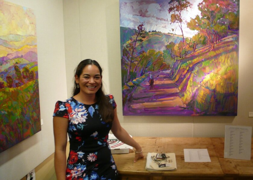 Artist Erin Hanson welcomes guests at the Nov. 16 opening of her 'Colors of California' exhibit at La Jolla Library. Hanson said she paints with an Open Impressionism style using 'vivid colors, bold brush strokes and a fresh, modern style to capture the beautiful wine countries and coastal regions of California.'