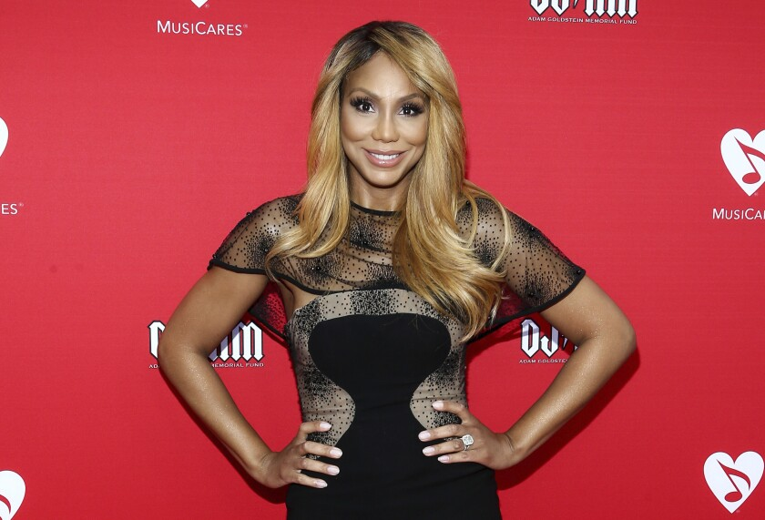 "FILE - In this May 19, 2016, file photo, Tamar Braxton attends the 12th annual MusiCares MAP Fund Benefit Concert in Los Angeles. WE tv says it will honor Braxton's request to end future work together, but the network expects to premiere the singer's reality show next month. Her reality series called ""Tamar Braxton: Get Ya Life!"" was expected to premiere last week, but has been postponed to Sept. 10. (Photo by John Salangsang/Invision/AP, File)"