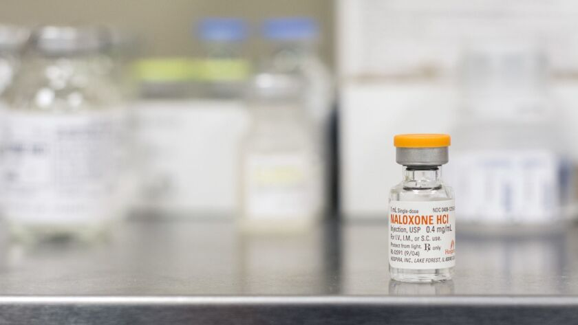 Naloxone vial on medical table for drug overdose