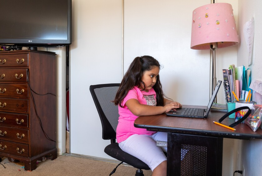 Ariana Garcia, 7,  learns using a computer in a bedroom at her home in Oceanside