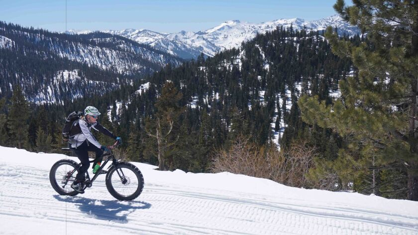 Ken Long of Tahoe Mountain Guides pedals on the Fiberboard Freeway, a snowmobile trail on Sawtooth Ridge near Truckee.