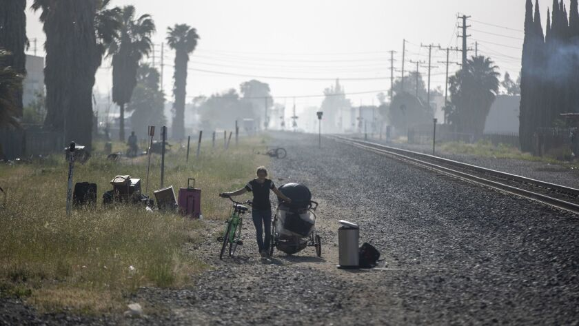 CHATSWORTH, CALIF. -- THURSDAY, APRIL 25, 2019: A homeless woman walks along the railroad right-of-w
