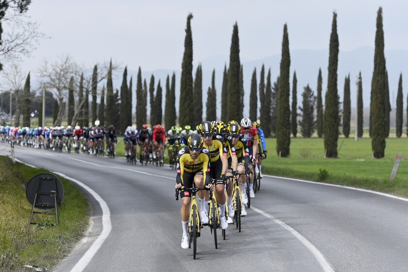 Cyclists pedal during the second stage of the Tirreno Adriatico cycling race, from Camaiore to Chiusdino, Italy, Thursday, March 11, 2021. (Marco Alpozzi/LaPresse via AP)