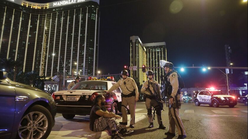 Officers gather at the scene of the Oct. 1 mass shooting near the Mandalay Bay casino in Las Vegas.