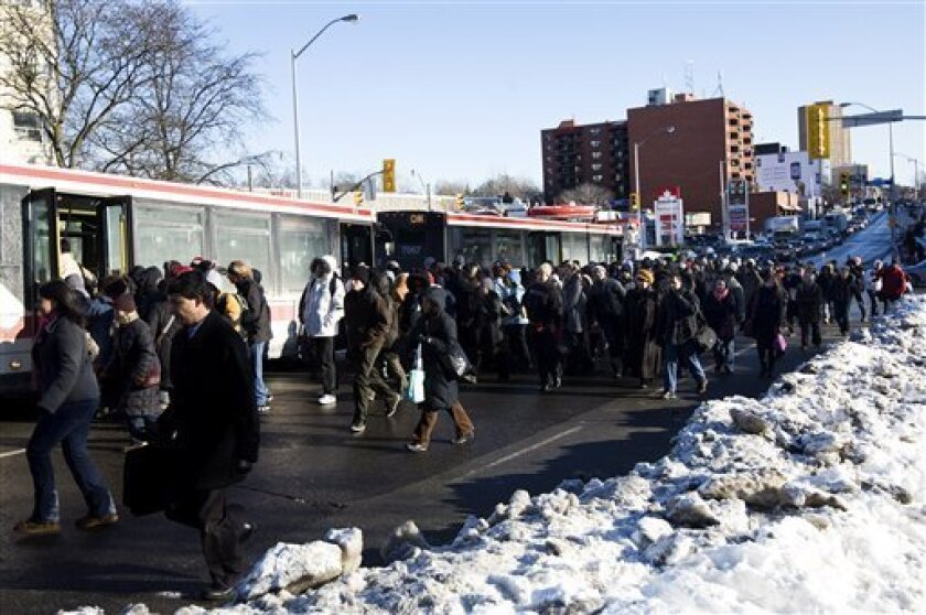 Traffic was jammed as people flood the streets trying to get on buses  in near zero temperatures in Toronto on Friday, Jan. 16, 2009. The subway line and about 100,000  people were without power after an outage, which began late Thursday when a broken water main flooded a power station.(AP Photo/Th