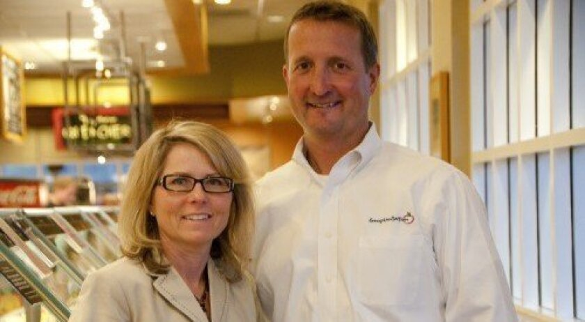 Tammy Bailey, chief market officer of Garden Fresh Restaurant Corp., which operates nearly 130 Souplantation stores, stands with Carmel Valley general manager Alan Ryan, who has been with the company for 18 years. Photo: Claire Harlin