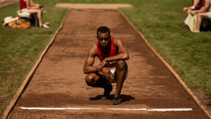 """This photo provided by Focus Features shows Stephan James as Jesse Owens in Stephen Hopkins' """"Race,"""" a Focus Features release. The movie opens in theaters Friday, Feb. 19, 2016.  (Thibault Grabherr/Focus Features via AP)"""