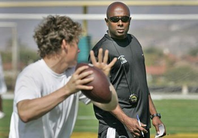 Former first-round draft pick Akili Smith (right), a Lincoln High 
