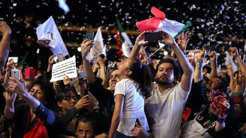MEXICO CITY, -- SUNDAY, JULY 1, 2018: Supporters of Andrés Manual López Obrador cheer as he makes a