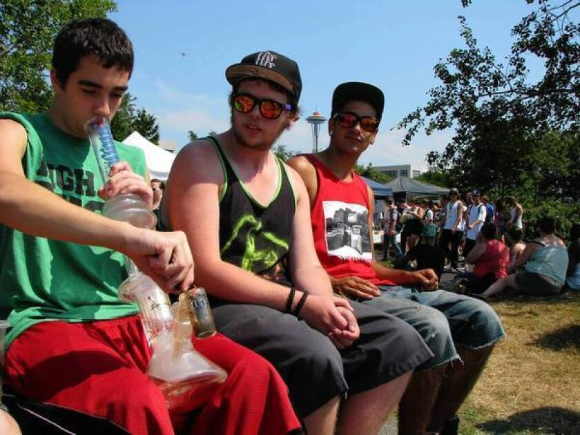 A pot fan uses a bong at Seattle's annual Hempfest. Opinion at the festival is divided sharply over a statewide initiative to legalize possession of small amounts. Medical users fear strict provisions against impaired driving.