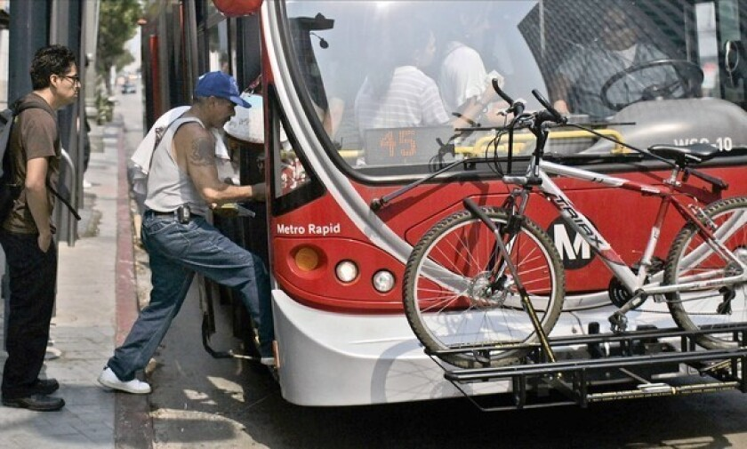 Riders board a Metro Rapid bus. Metropolitan Transportation Authority buses are sprayed quarterly for pests,but severe infestations can require additional applications.
