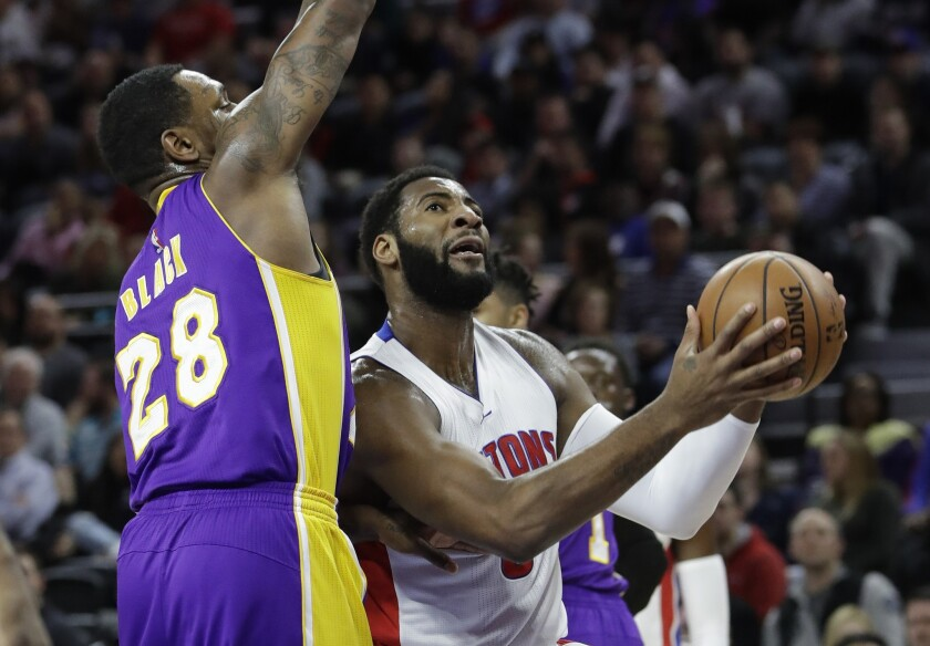 Pistons center Andre Drummond drives down the lane against Lakers center Tarik Black during the first half.