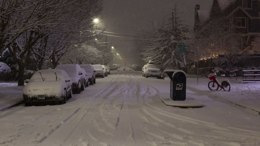 In Seattle, officials urged people to stay off the roads as traffic slowed to a standstill in some places because of the snow.