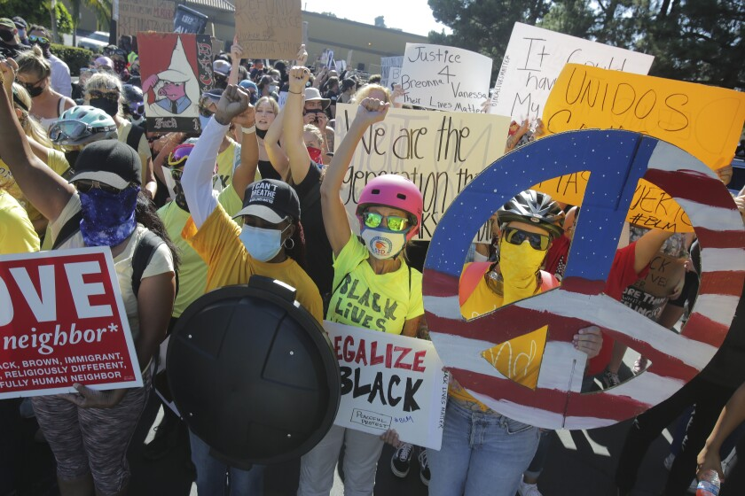 Protesters rally for a Black Lives Matter in La Mesa on Saturday, Aug. 1.