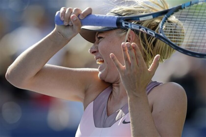 Maria Sharapova, of Russia, returns a shot to Mallory Burdette in the third round of play at the 2012 US Open tennis tournament,  Friday, Aug. 31, 2012, in New York. (AP Photo/Mike Groll)
