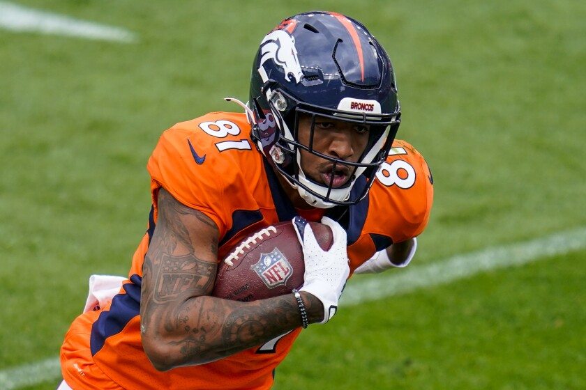 FILE - In this Sept. 27, 2020, file photo, Denver Broncos wide receiver Tim Patrick runs for a touchdown against the Tampa Bay Buccaneers during an NFL football game in Denver. Heading into Sunday's game against Kansas City (5-1), Patrick leads the Broncos (2-3) with 20 receptions for 310 yards and two touchdowns. (AP Photo/Jack Dempsey, File)