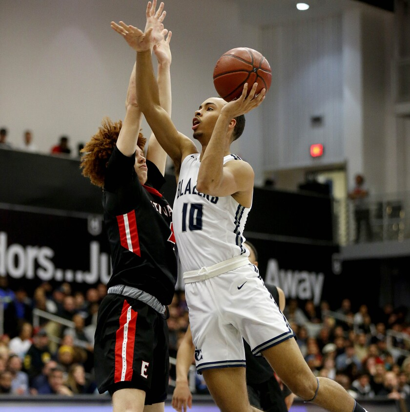 Sierra Canyon's Amari Bailey drives to the basket while guarded by Etiwanda's Brantly Stevenson.