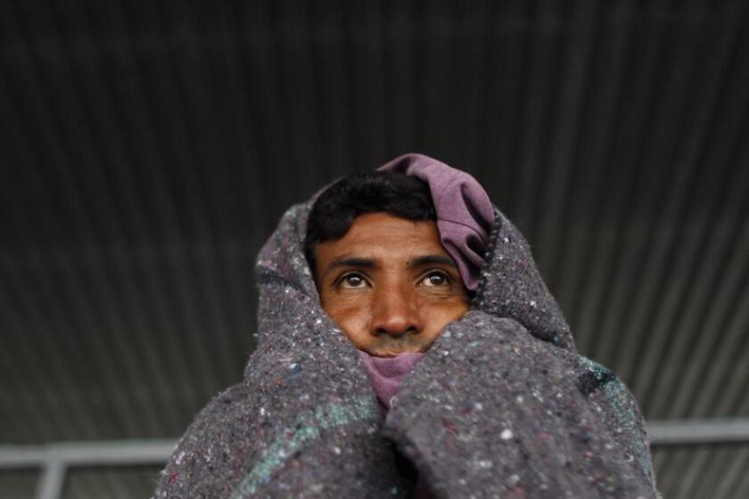 A Central American migrant protects himself from the cold as he rests at the Jesus Martinez 'Palillo' sports stadium in Mexico City, Mexico, Nov. 14, 2018. EPA-EFE/Sashenka Gutierrez