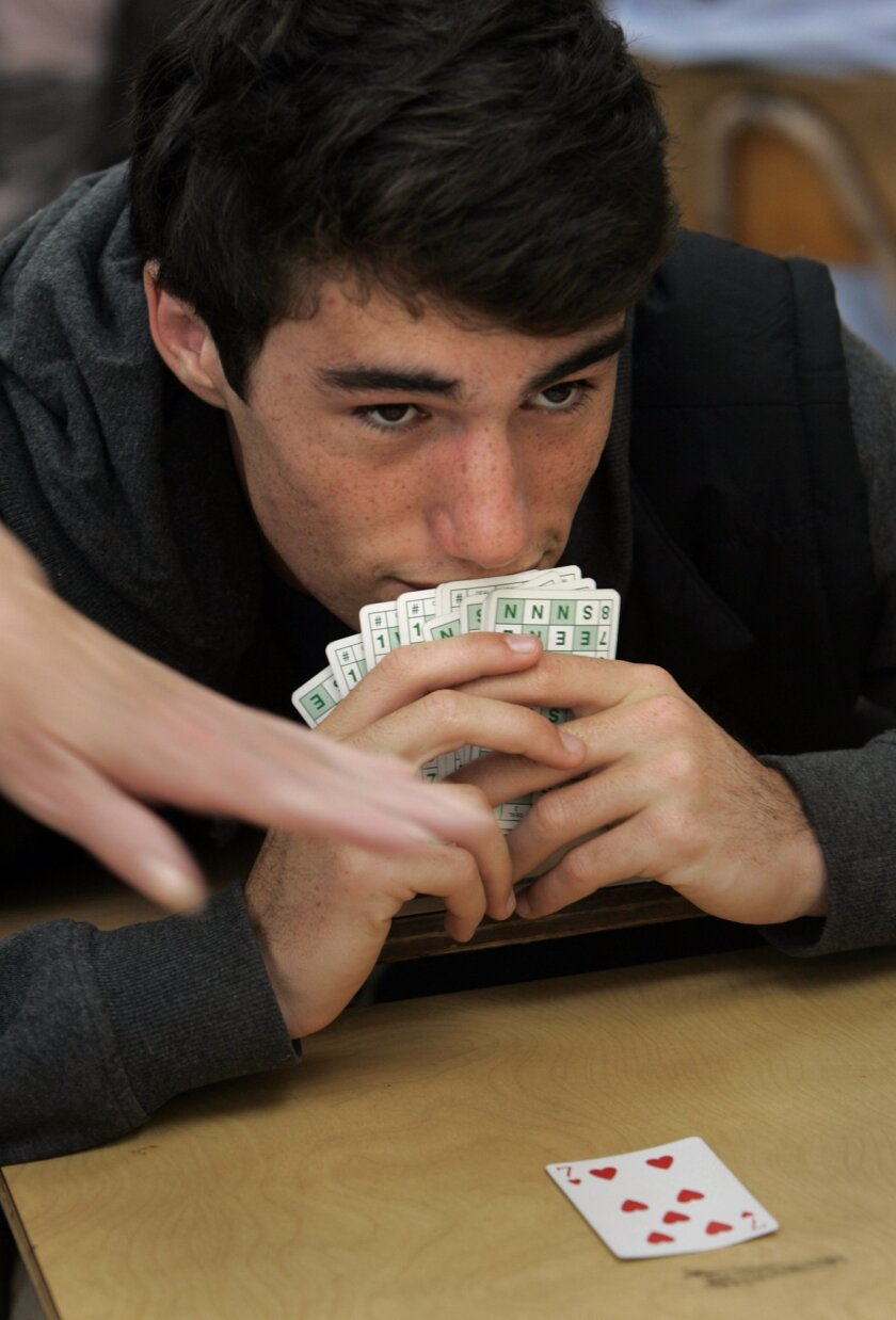 La Jolla High student Kyle Gutstadt, 17, studies his opponents and the cards during a game of bridge Wednesday in math class.